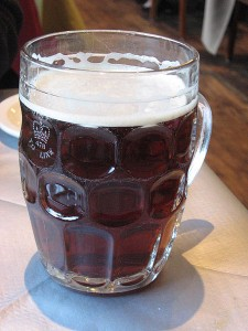 British_dimpled_glass_pint_jug_with_ale