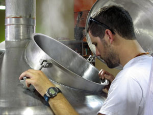 Ben Mills checks the boil of his sour beer.