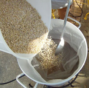 "Adding grain, or ""doughing in"" with a bag-lined kettle"