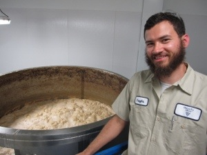 Arcadia Brewing Manager Vaughn Stewart next to an open fermenter